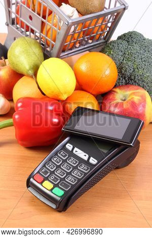 Payment Terminal, Credit Card Reader With Mobile Phone With Nfc Technology And Fresh Fruits And Vege