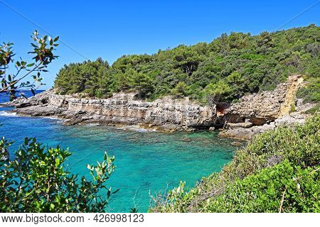 Beautiful Bay In Croatia On The Adriatic Sea With Stone Cliffs And Turquoise Blue Water, Popular Tou