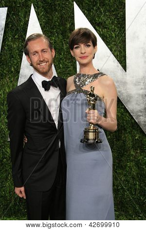 WEST HOLLYWOOD, CA - FEB 24: Adam Shulman, Anne Hathaway at the Vanity Fair Oscar Party at Sunset Tower on February 24, 2013 in West Hollywood, California