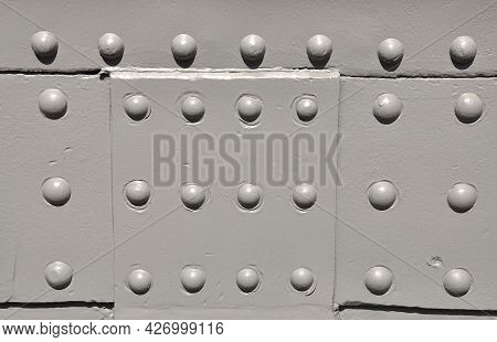 Industrial Steel Plate With Grey Round Rivets