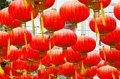 Red Chinese Lanterns decorate in Bangkok's Chinatown during the Chinese New Year celebration poster