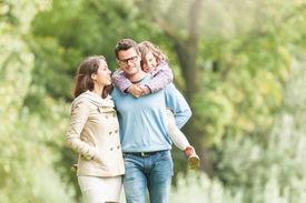 Happy family of three having fun outdoor.