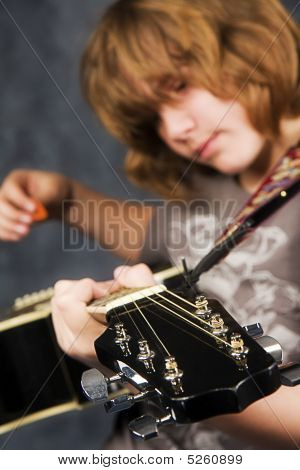 Preteen Playing Guitar