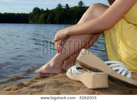 Sitting By Lake With Sandals