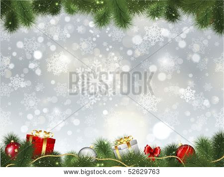 Christmas background of gifts and decorations in fir tree branches