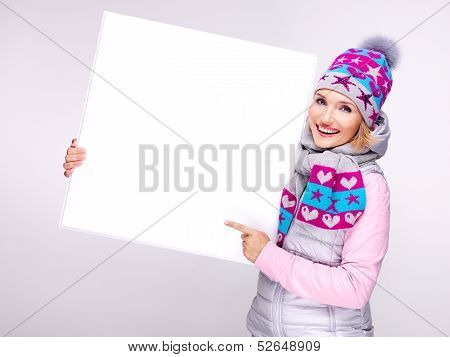Woman In Warm Outerwear  Holds The Banner And Points On It