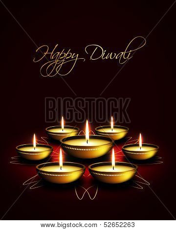 Oil Lamp With Diwali Greetings Over Dark Background