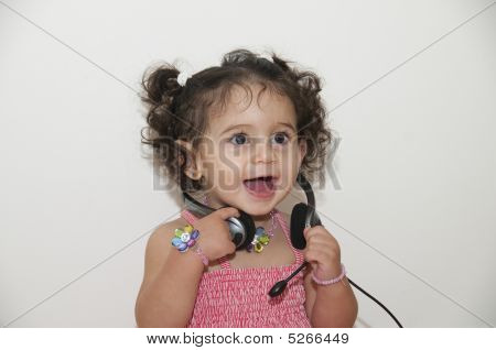 A Happy Girl With A Headphone