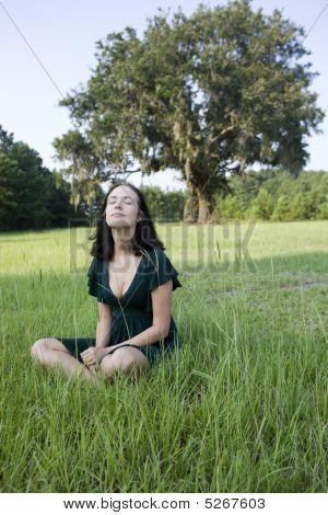 Smiling Girl Sitting In Field