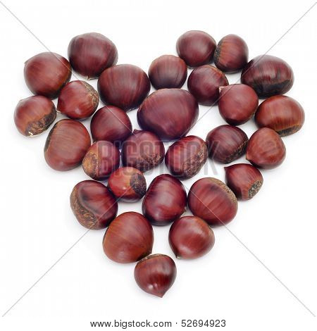 a pile of chestnuts forming a heart on a white background