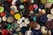 Pile of old buttons of different color poster