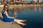 girl in a blue dress on the background of the river. Ukraine. Kiev. Obolon poster