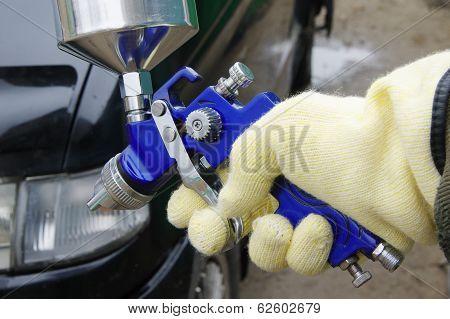 Worker Using A Paint Spray Gun
