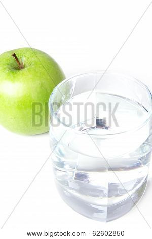 Glass With Water And One Green Apple