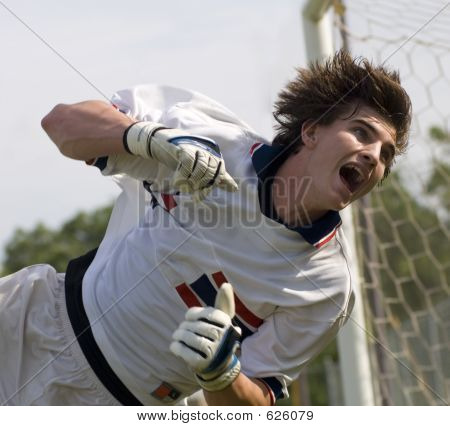Soccer Football Goal Keeper Straining For Save