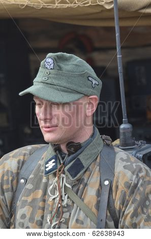 KIEV, UKRAINE -NOV 3: An unidentified members of Red Star history club wear historical German uniform during historical reenactment of WWII, Dnepr river crossing 1943, November 3, 2013. Kiev, Ukraine