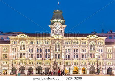 The City Hall, Palazzo del Municipio, is the dominating building on Trieste's main square Piazza dell Unita d Italia. Trieste, Italy, Europe. Illuminated city square shot at dusk. poster