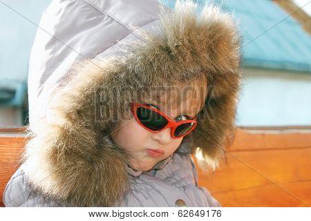 Portrait Of Cute Little Girl In Winter Season