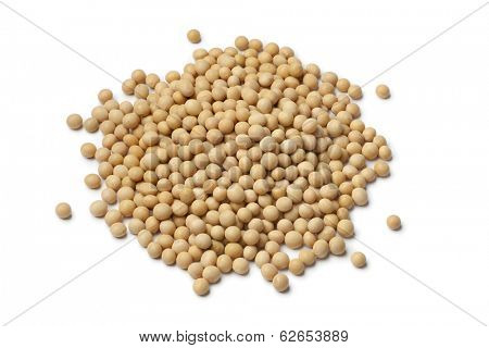Heap of dried soybeans on white background