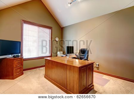 Office Room With High Vaulted Ceiling