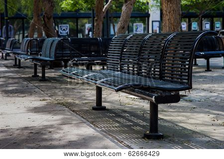 many steel benches are located in park poster