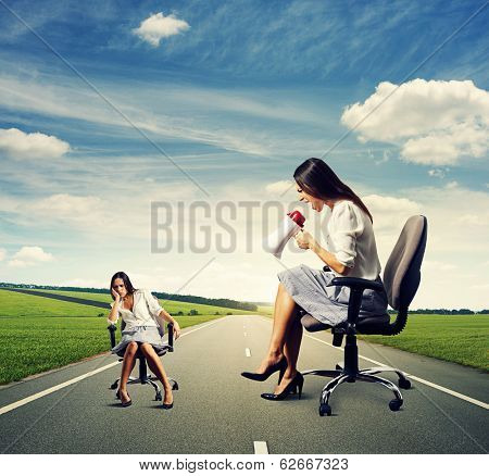 dismal woman and angry screaming woman on the road