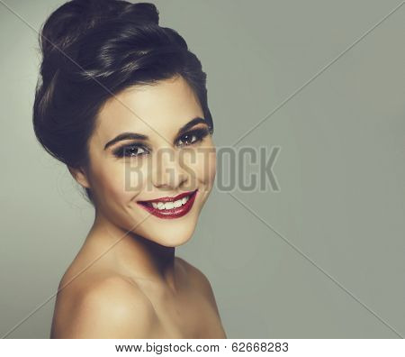Beautiful smiling young woman undo hair style