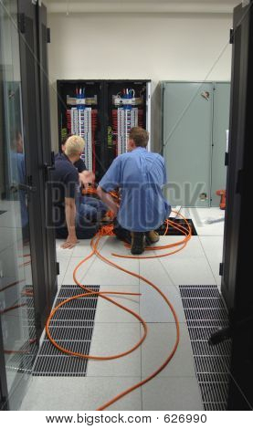 Electricians Installing Additional Power Cables