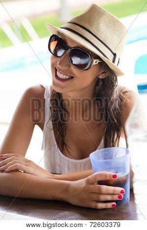 Beautiful Girl Drinking In The Pool Bar.