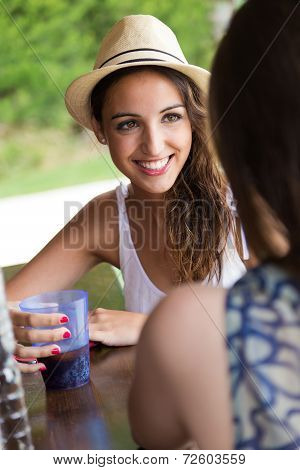 Beautiful Girl Drinking In The Pool Bar With Friend.
