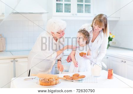 Grandmother Having Fung With Her Daughter And Granddaughter - A Cute Toddler Girl - Baking A Pie poster