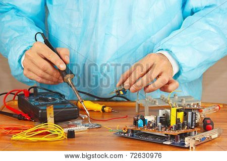 Soldering electronic components of device in the service workshop poster