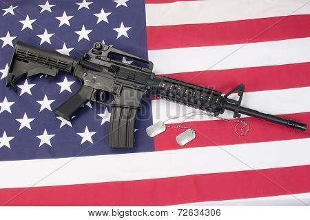 M4A1 Carbine With Blank Dog Tags On Us Flag