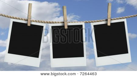 three  photos hanging with blue sky