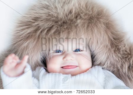 Funny Cute Baby Girl With Big Blue Eyes Wearing A Huge Winter Hat