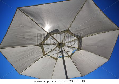 Sunshade in the blue sky