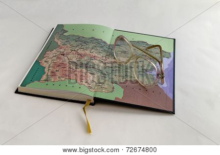 Old open notebook with map of Bulgaria