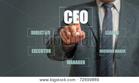 Business Man Touching An Imaginary Screen And Choosing CEO