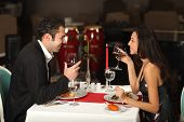 Romantic couple having dinner smiling to each other poster