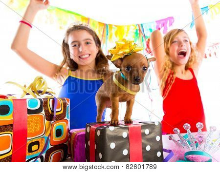 girl friends party dancing with presents and puppy chihuahua dog in birthday