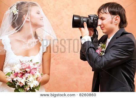 Husband Taking Picture Of His Wife