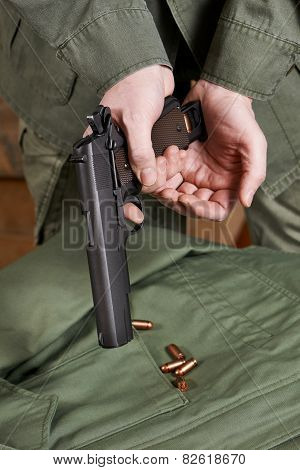 Soldiers load clip with cartridges into gun closeup poster