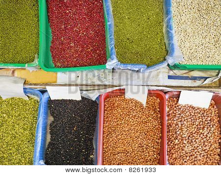 Various beans and nuts for sale in an Asian market poster