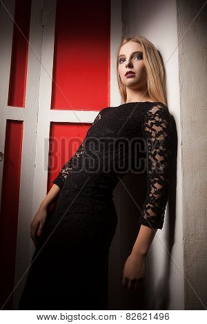 Woman In Black Dress In Red Vintage Interior