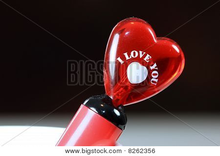 Glassy heart with I Love You note