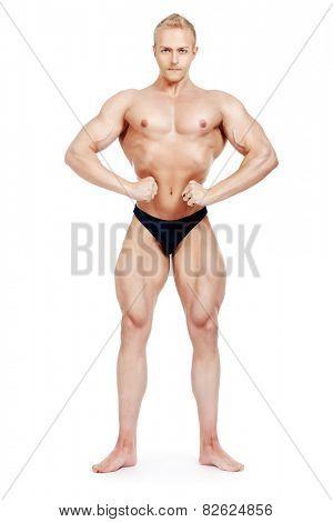 Full length portrait of professional sportsman bodybuilder man. Isolated over white.