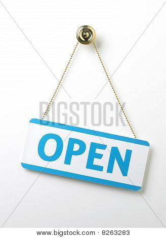 Process Blue Angled Open Door Sign On A Brass Chain On A White Background