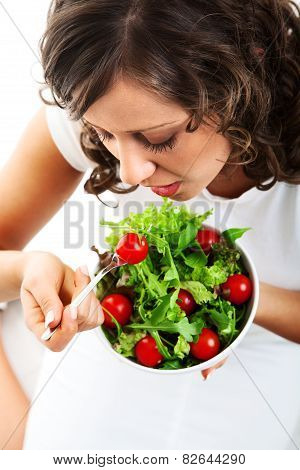 Young Woman Preparing Healhty Salad