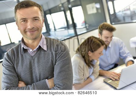 Businessman attending meeting with workteam