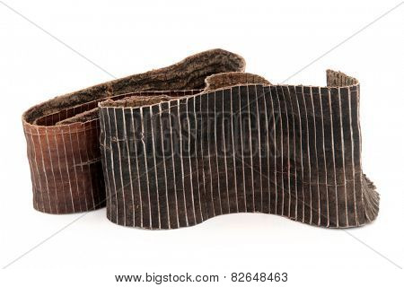 Hardy rubber tree bark used in chinese herbal medicine over white background. Du zhong. Eucommiae.